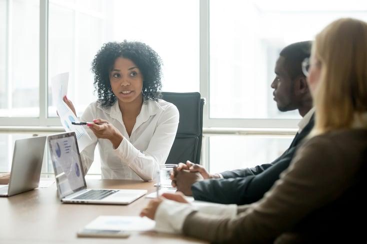 African businesswoman showing good statistics convincing multira