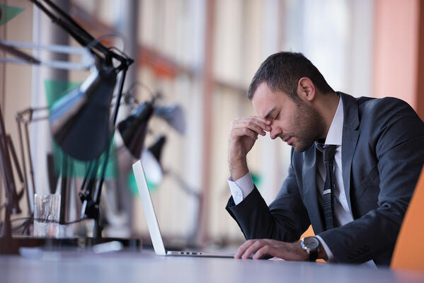 Frustrated young business man