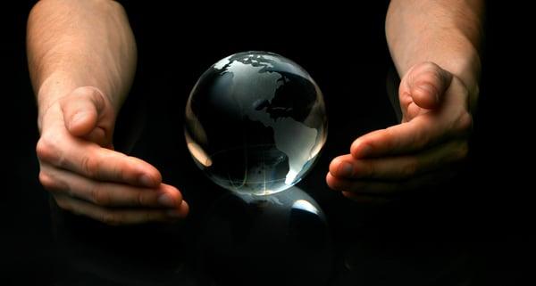 Hands around of globe