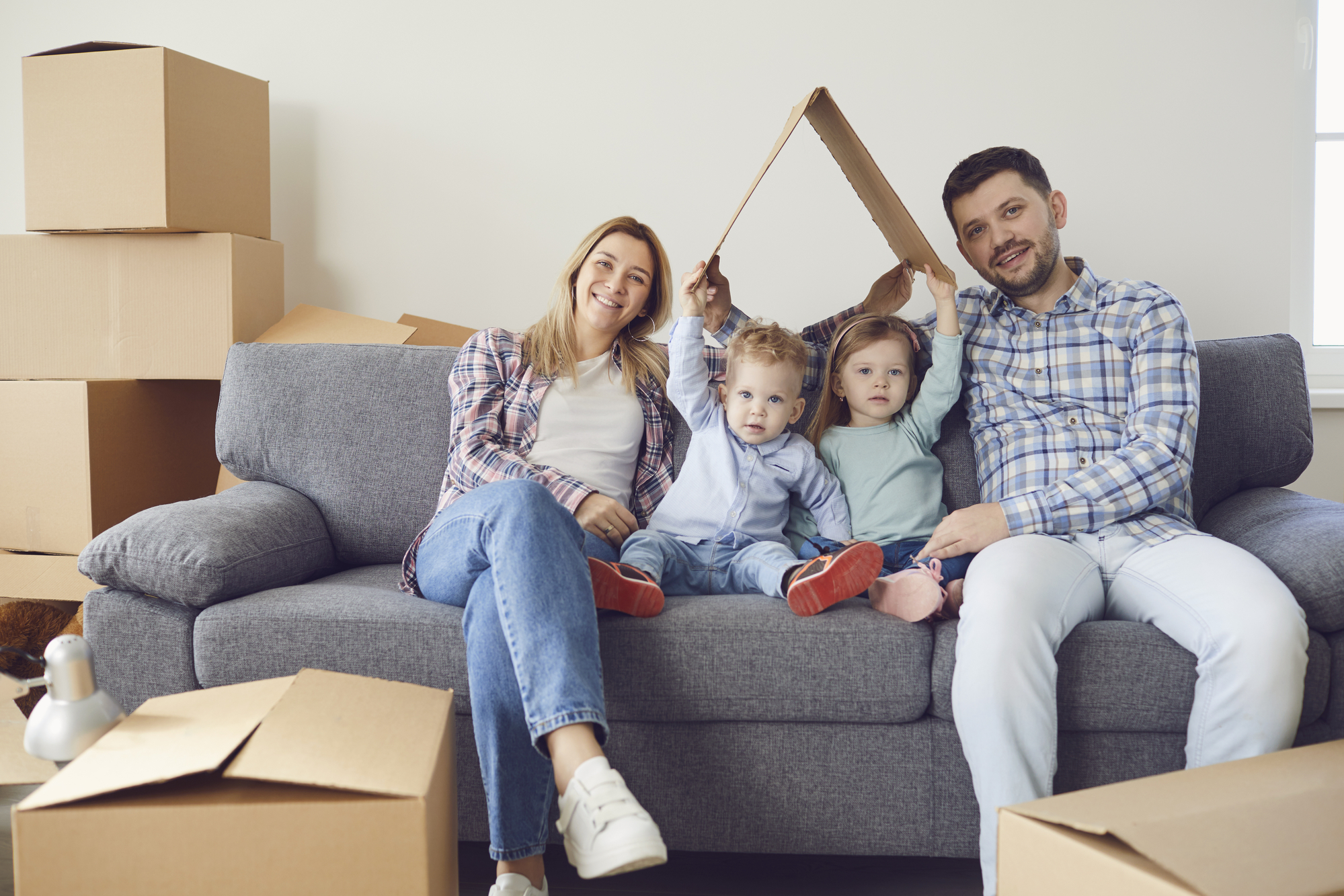 Happy family smiling at a new house moving