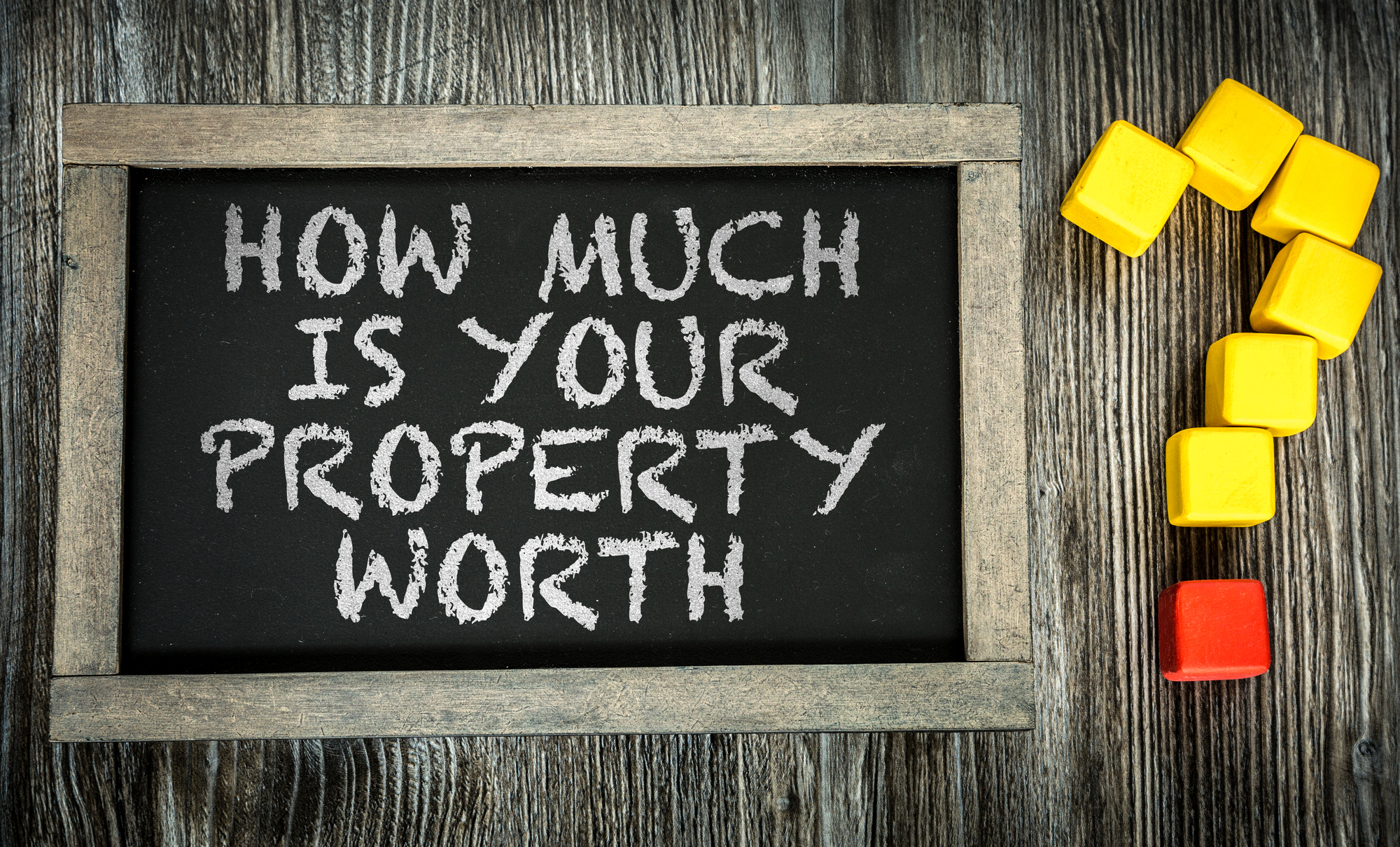 How Much is Your Property Worth on chalkboard