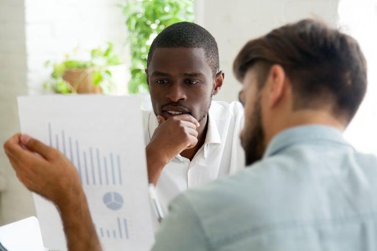 Interested black client listening to financial advisor explaining