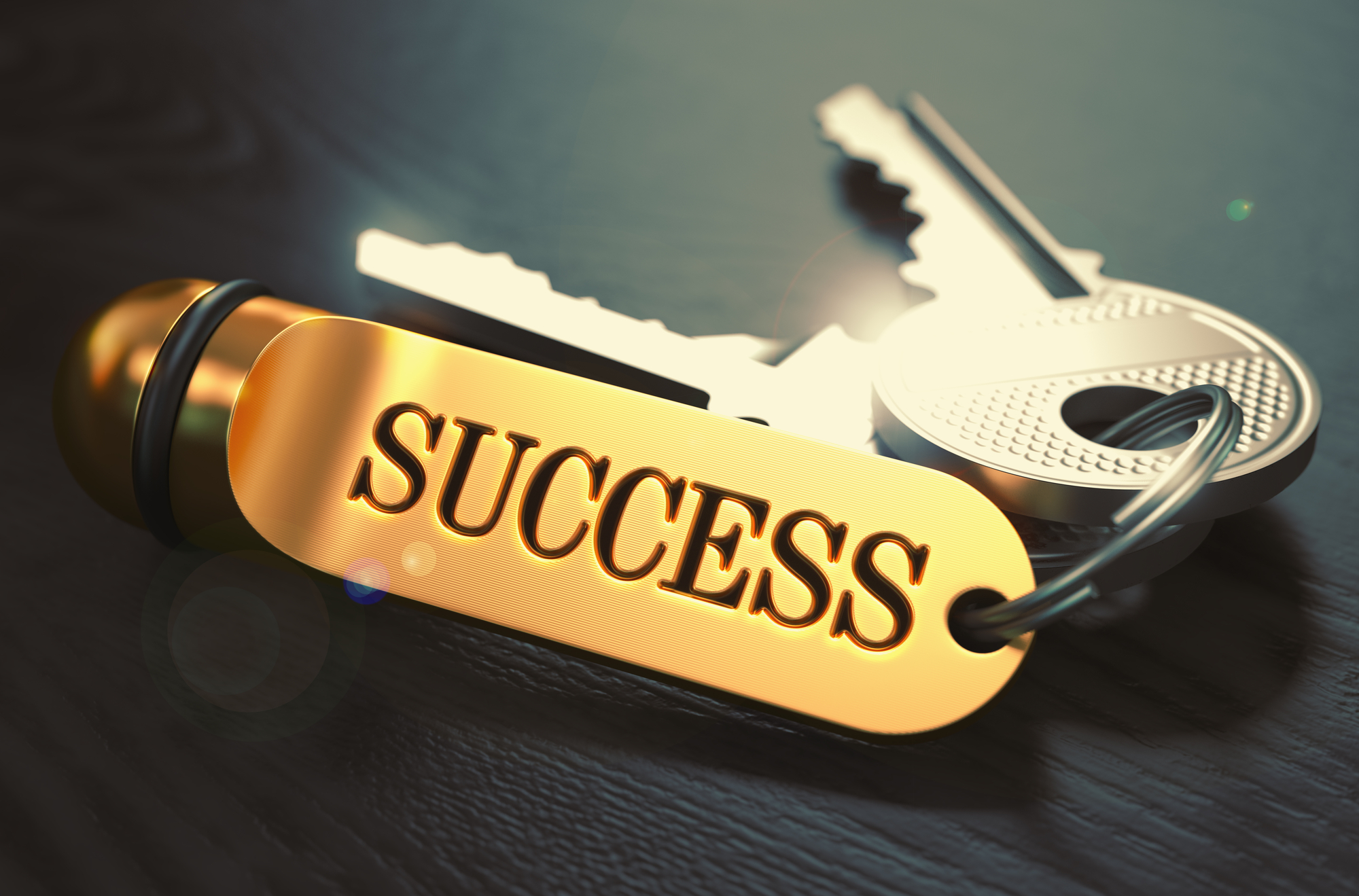 Keys to Success. Concept on Golden Keychain