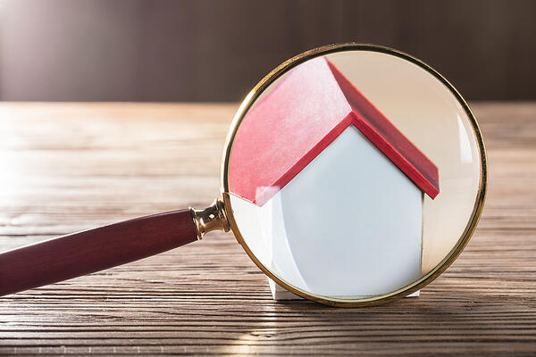 Magnifying glass on house