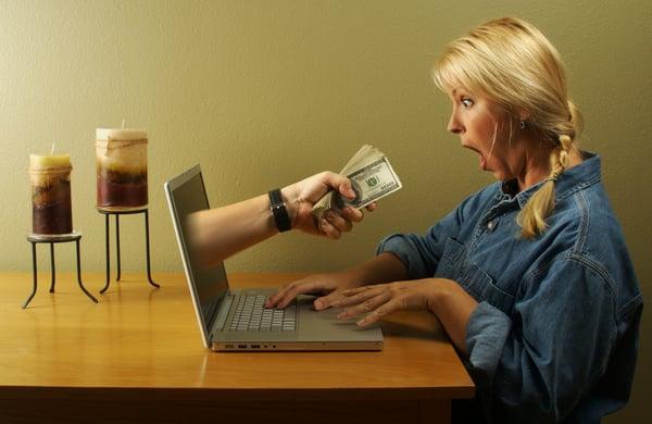 Money Through Laptop Screen and Woman