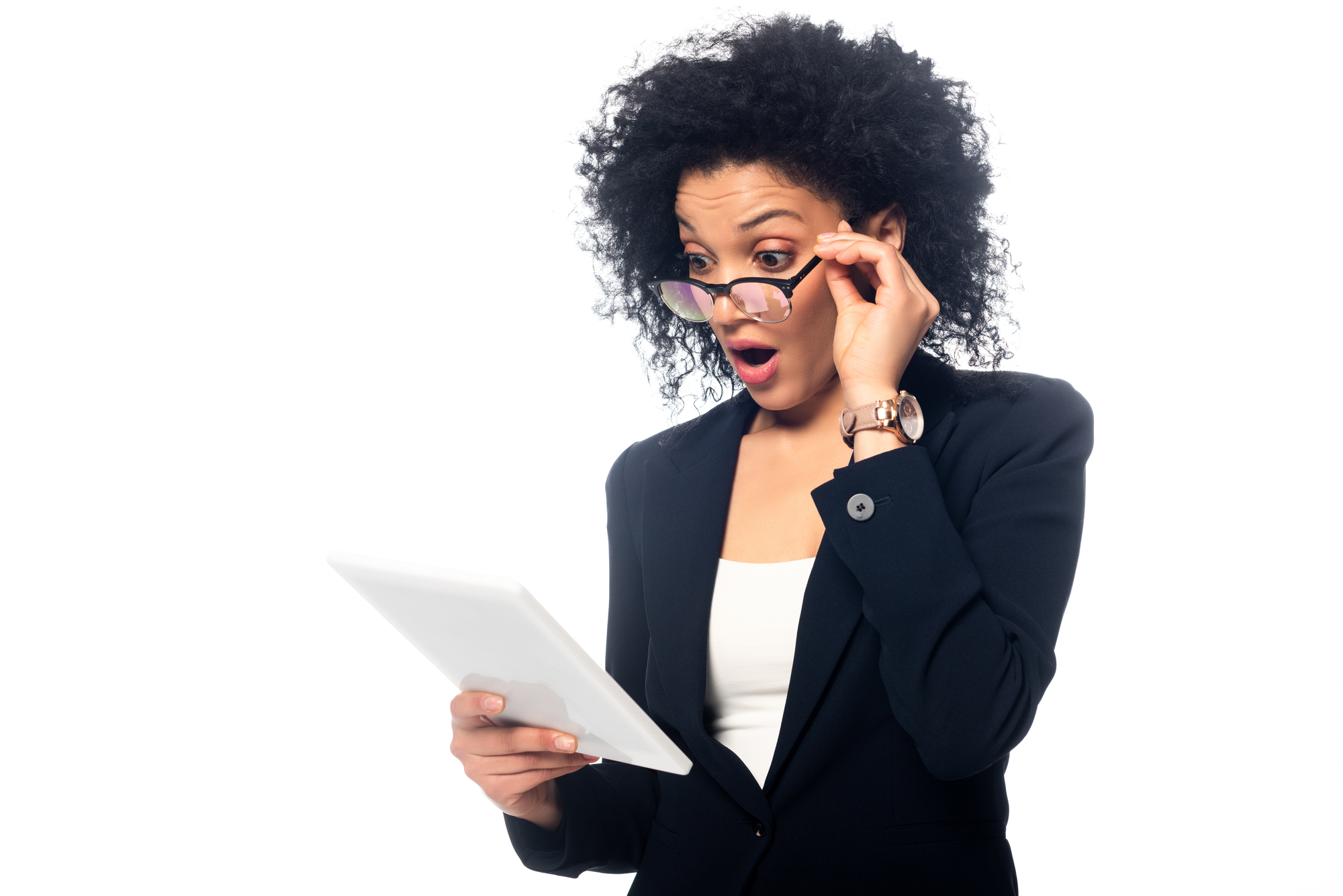 Shocked and surprised african american businesswoman looking at digital tablet isolated on white