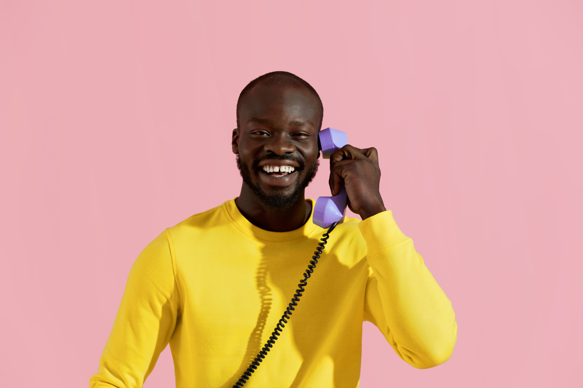 Smiling black man with purple phone colorful portrait
