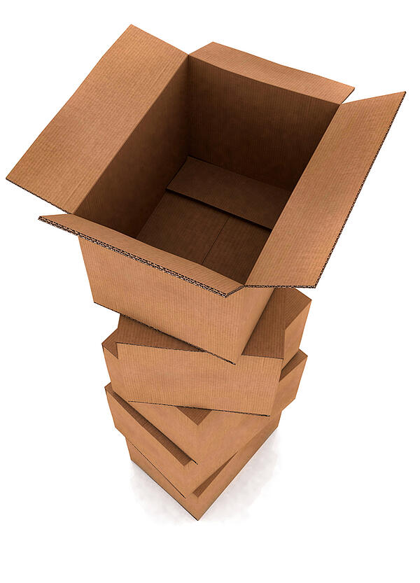 pile of cardboard boxes in high detail with the top one open - isolated over a white background
