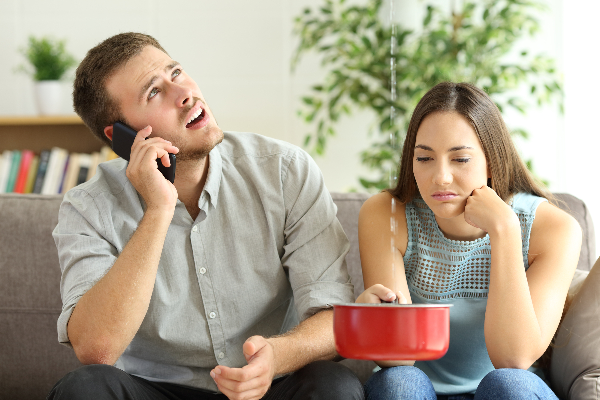 couple calling insurance for home