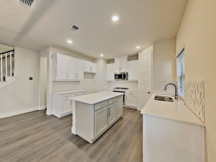 Beautiful Plano rental home with vinyl plank floors updated kitchen